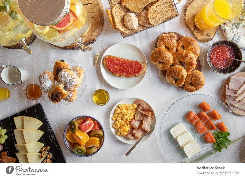 Assorted food table with baked products seafood fruit juices breakfast buffet assortment smorgasbord meal delicious choice healthy variety brunch cuisine