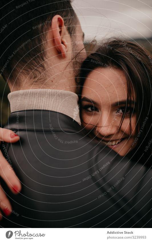 Happy couple hugging coniferous love date happy passion glad forest relationship romance intimate smile pleasure caress embrace enjoy gentle affection