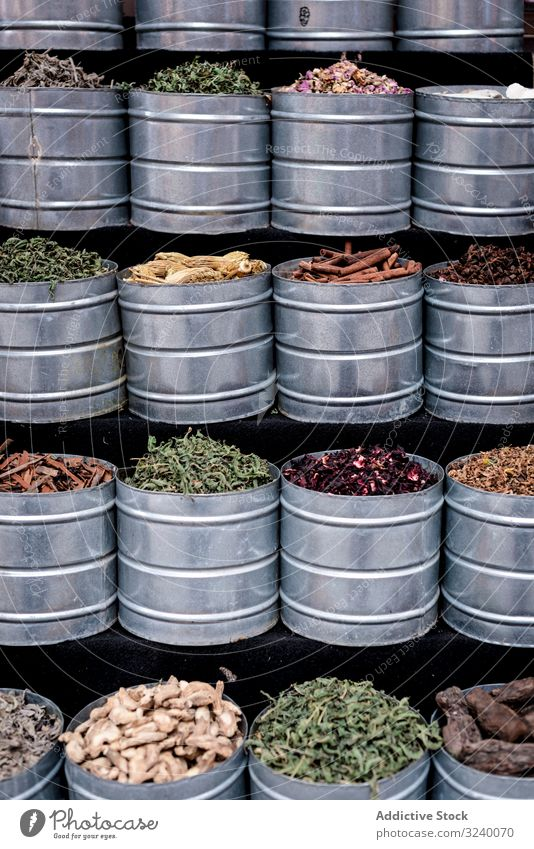 Metal containers with herbs spice market stall jar sell dry traditional assortment marrakesh morocco bazaar arabic city town trade aroma sale street marketplace