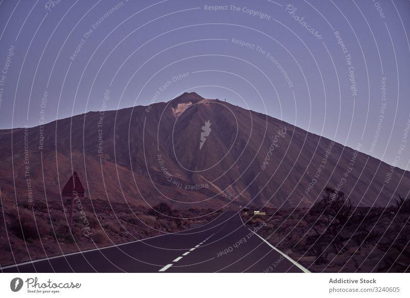 Close-up of a road in Tenerife, Spain mountain landscape journey volcano asphalt surrounded rocky el teide tenerife spain canary island adventure distance sky