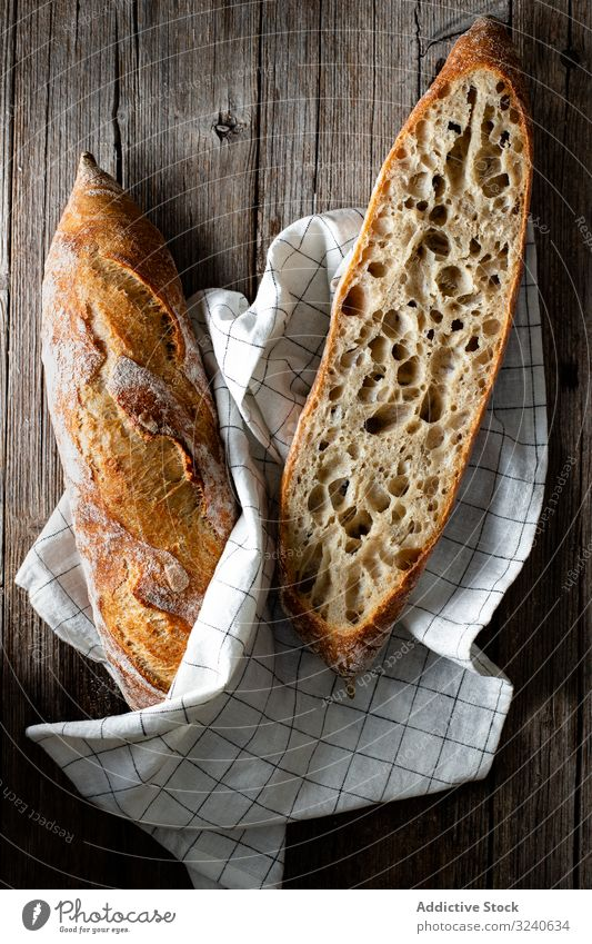 Fresh baguettes on checkered towel bread food fresh homemade delicious tasty bakery gourmet french cuisine sourdough baked product healthy appetizing pastry