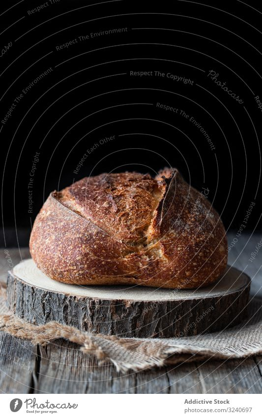 Country sourdough bread on wood loaf fresh baked piece whole rustic country bakery food homemade nutrition pastry cuisine tasty delicious yummy crunchy crust