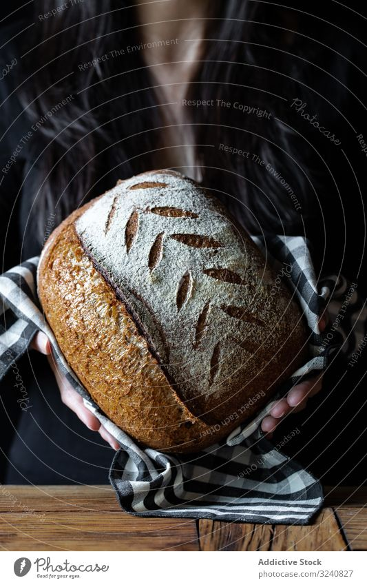 Crop person holding some bread fresh seed show meal food cuisine kitchen home snack rustic baked healthy delicious tasty yummy gourmet homemade nutrition