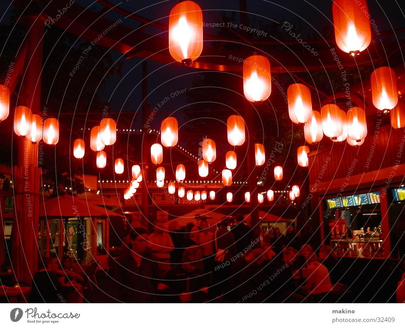 tivoli Amusement Park Lantern Cotton candy Red Club Party Evening Human being Light
