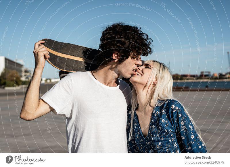 Trendy in love couple hugging on street skateboard embrace amour calm romance boyfriend girlfriend charming romantic effortless relationship confident trendy
