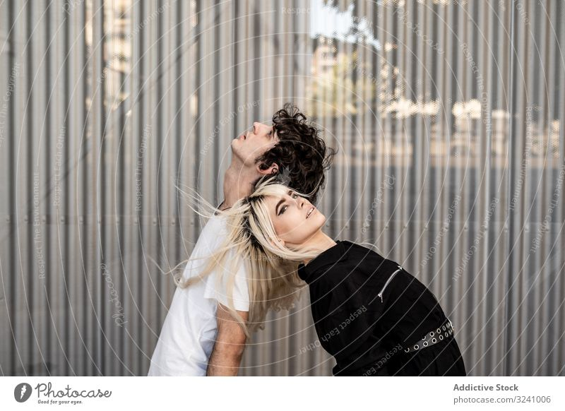 Loving man and woman supporting each other while standing back to back couple trust love dream loyalty relationship amour soulmate feelings hope affection