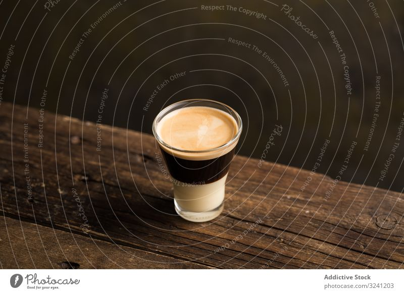 Cups of tasty hot coffee drink on wooden table glass cup beverage delicious froth refreshment sweet flavor saucer aromatic caffeine addicted cappuccino latte