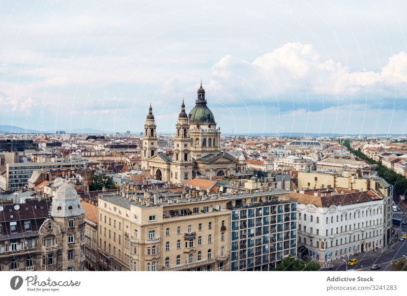 Majestic cathedral over buildings and houses in bright cloudy day cityscape architecture travel budapest geometric tourism hungary church historic old famous