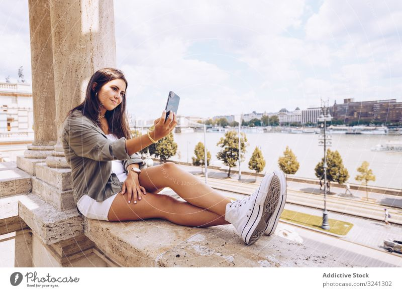 Woman taking selfie on old building woman travel architecture smartphone using dome budapest shape social media city urban tourism geometric memory gadget tower