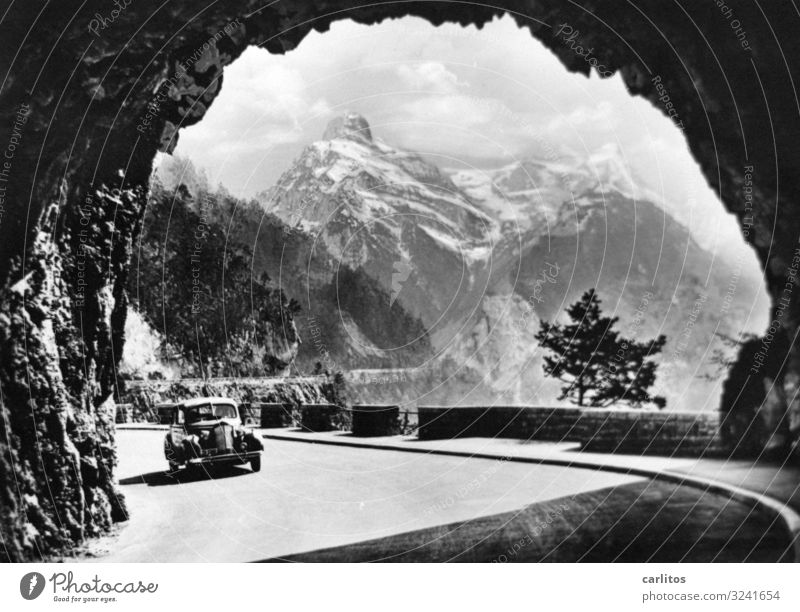 Gateway to the world Alps Car Vintage car Tunnel Mountain Panorama (View) Black & white photo Vacation & Travel Travel photography Experience