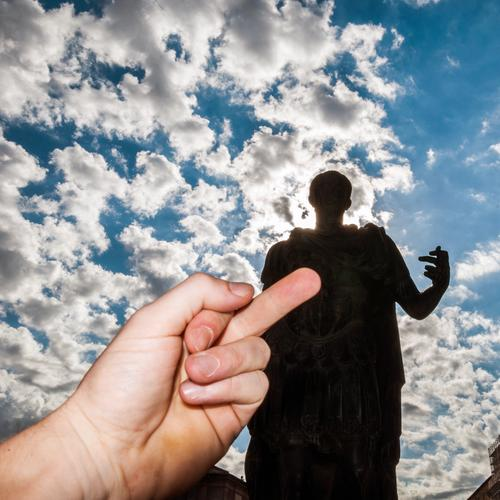 SIGHTSEEING Vacation & Travel Tourism Sightseeing City trip Man Adults Hand Sky Clouds Beautiful weather Caesar Statue Tourist Attraction Give the finger