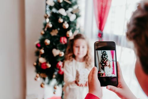 brother taking a picture of his sister with mobile phone Lifestyle Joy Playing Winter House (Residential Structure) Christmas & Advent Cellphone PDA Screen