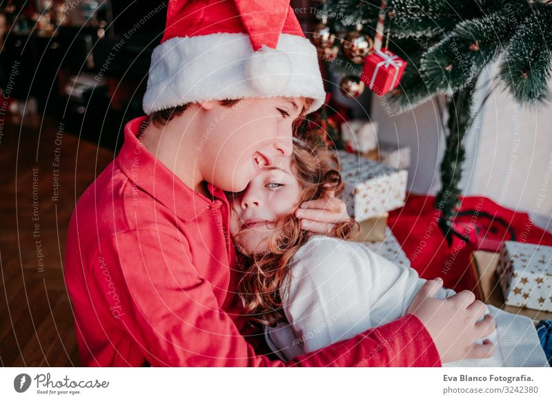 brother and sister at home. christmas concept Child Human being Christmas & Advent Beautiful Red Tree House (Residential Structure) Joy Winter Girl Lifestyle
