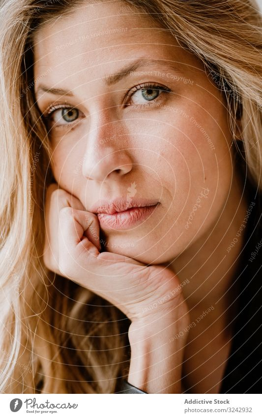 Beautiful blonde woman stylish pensive natural trendy contemplate curly female long haired beauty attractive alone casual romantic charming model smart