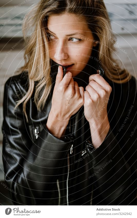 Beautiful blonde woman stylish pensive natural trendy contemplate curly female long haired beauty leather jacket attractive alone casual romantic charming model