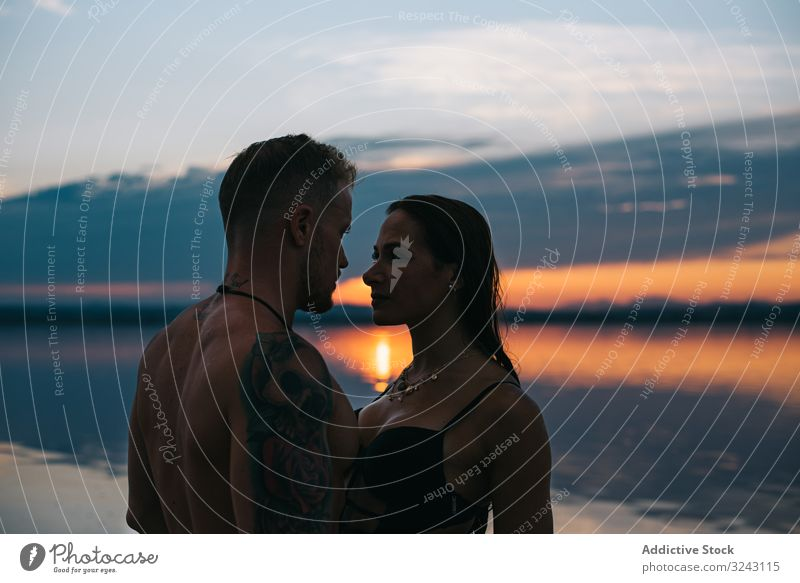 Couple hugging on beach of lake at sunset couple romantic vacation honeymoon nature summer harmony silhouette holiday together torrevieja alicante spain love