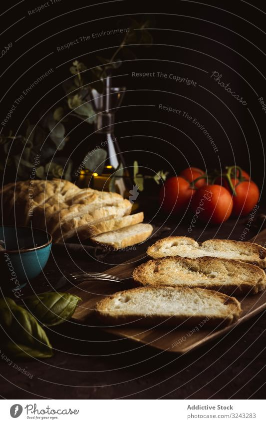 Toasts ingredients on dark table toast bread basil tomato food meal fresh rustic traditional dinner lunch delicious tasty bruschetta yummy crunchy crust piece