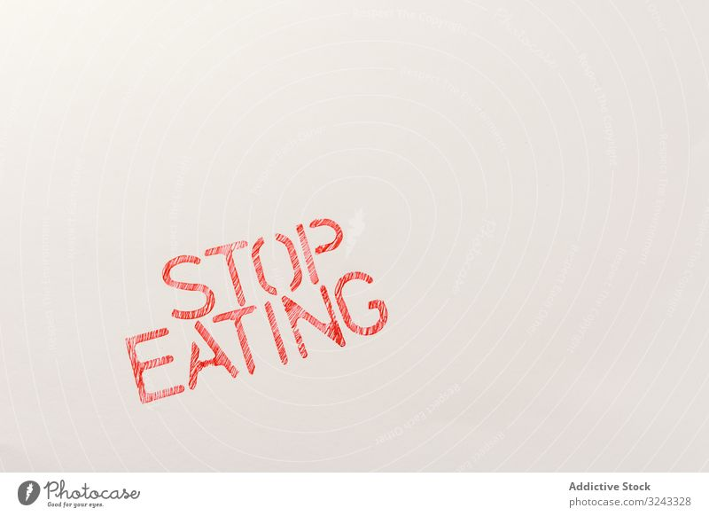 Simple red inscription calling to stop eating concept control prohibition refuse consuming slogan vegan obesity protection meat activist free diet food demand