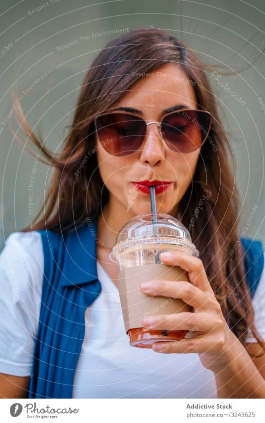 Cheerful woman enjoying fresh drink on street fruit smile city casual stylish cup female young urban healthy juice smoothie detox town trendy elegant lady straw