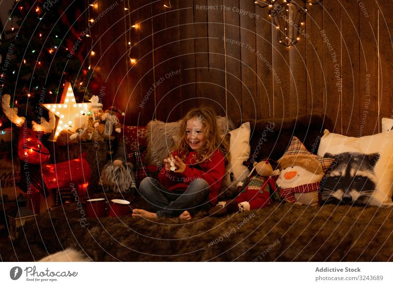 Little girl with teddy surrounded by christmas decoration kid decorating tree celebration home child holiday childhood winter season indoors holidays colorful