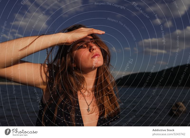Sensual woman resting on lake shore coast rock sensual summer young dreamy cloudy sky female water vacation weekend lifestyle nature countryside weather lady