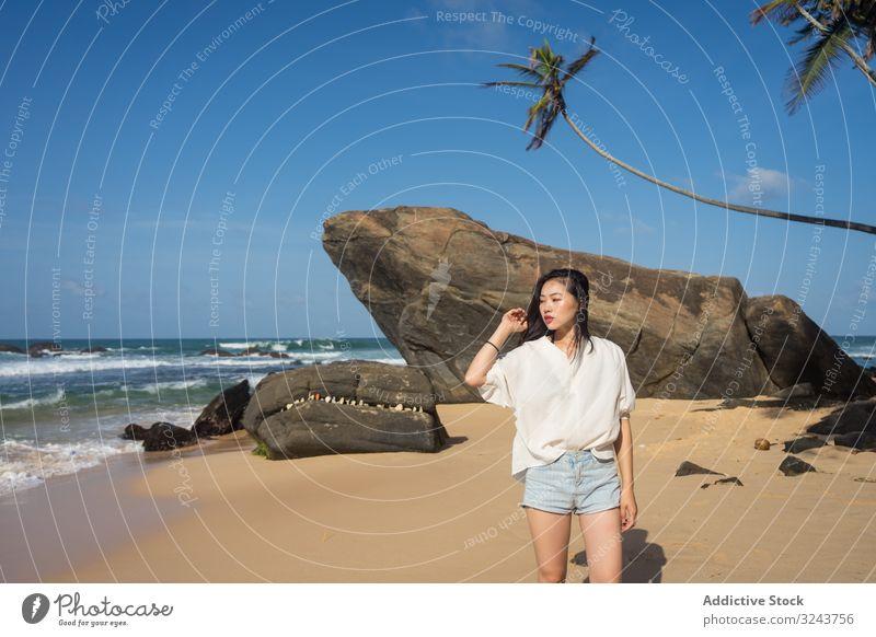 Woman in beachwear walking on sand barefoot Sri Lanka Mirissa beach woman beautiful summer young vacation ocean wave sensual nature beauty fashion water body