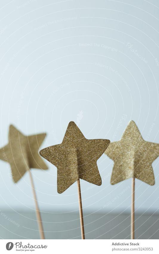 Cutout golden stars on stick for decoration christmas celebration holiday season present papercraft festive glitter gift small symbol shiny toy decorative