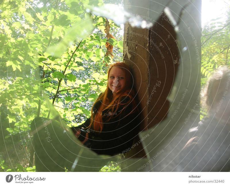on a railing Woman Girl Window Shard Broken Tree Green Black Hollow Column Handrail Garden Plant