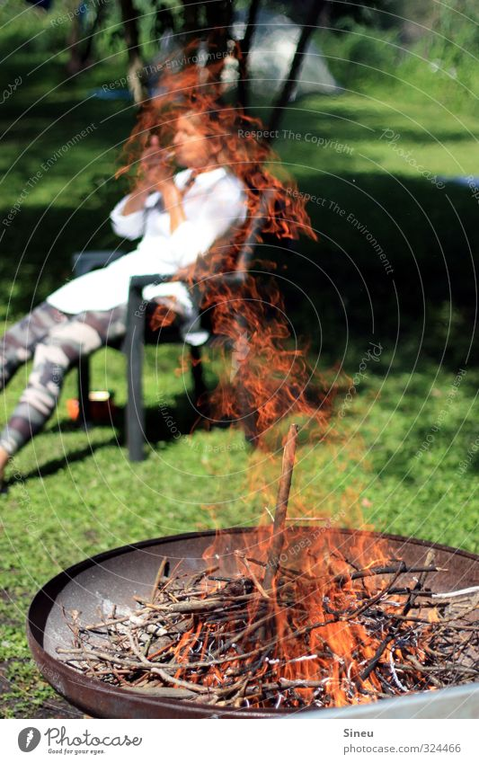 Smoking woman by the fire Smoker Cigarette Fire campfire fire bowl Summer BBQ Garden Weekend relaxation Warmth Wood Burn Burning wood Flame Embers Fireplace