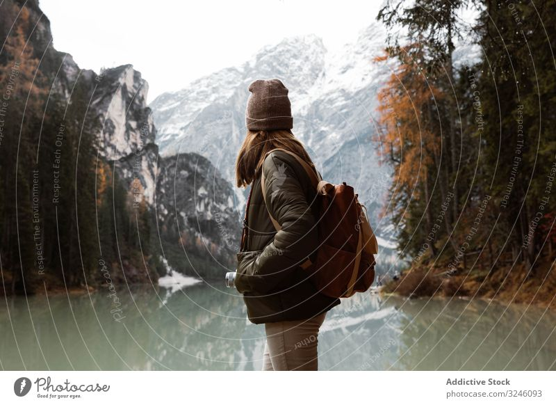 Woman delighting in views near lake and mountains tourism water boat fog cloudy mist travel landscape vacation adventure nature beautiful sky scenic holiday