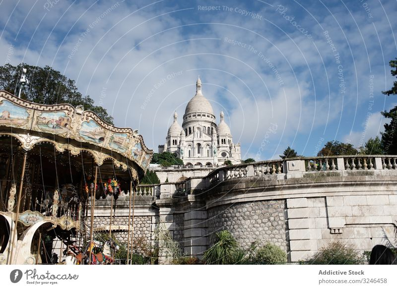 Elegant big cathedral with rocked fence on blue sky temple architecture travel church tourism ancient culture historic tower building city landmark destination