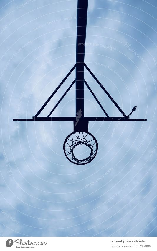 basketball hoop silhouette and blue sky on the street Basketball Sky Blue Silhouette circle Chain Metal Net Sports Sports equipment Playing Playful Old Street