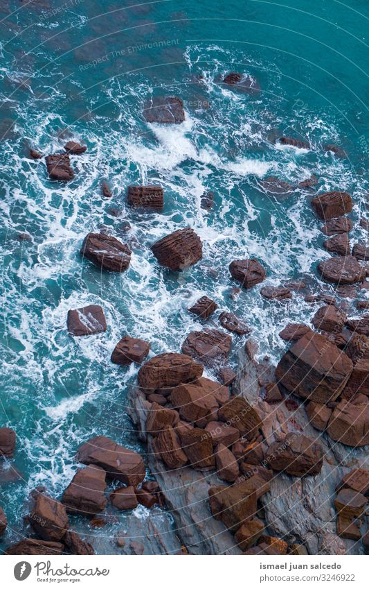 rocks on the blue sea in the coast in Bilbao Spain Rock Ocean Blue Waves Water Coast Exterior shot Vacation & Travel Destination Places Nature Landscape