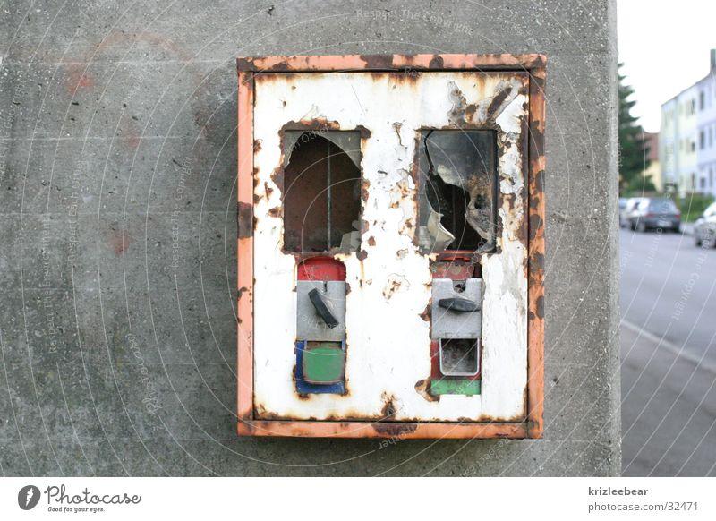 Burnt out Chewing gum Vending machine Broken Hideous Empty Vandalism Concrete Wall (building) Concrete wall Obscure