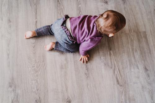 portrait of beautiful baby girl crawling at home Lifestyle Joy Leisure and hobbies Playing House (Residential Structure) Kindergarten Child Human being Feminine