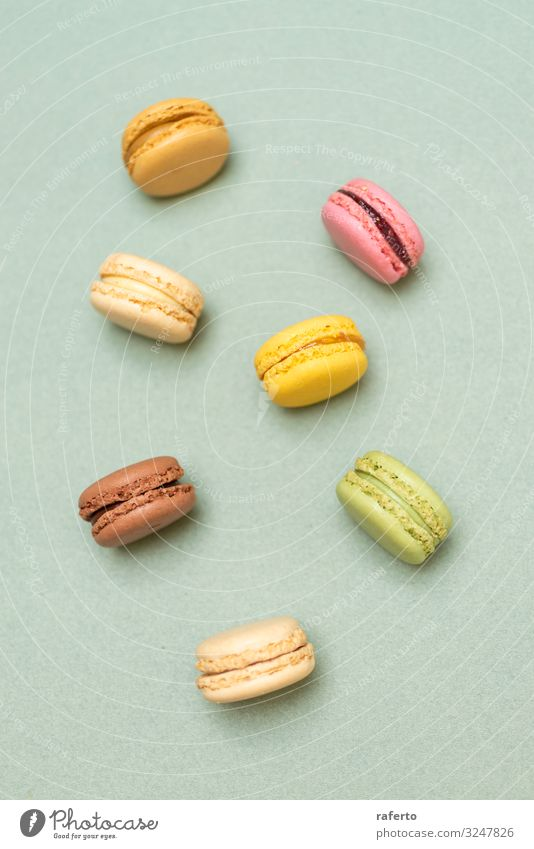 Colored tasty macaroons over a green background Colour Green Yellow Bright Fresh Photography Delicious Soft Baked goods Dessert Gastronomy Cooking Baking