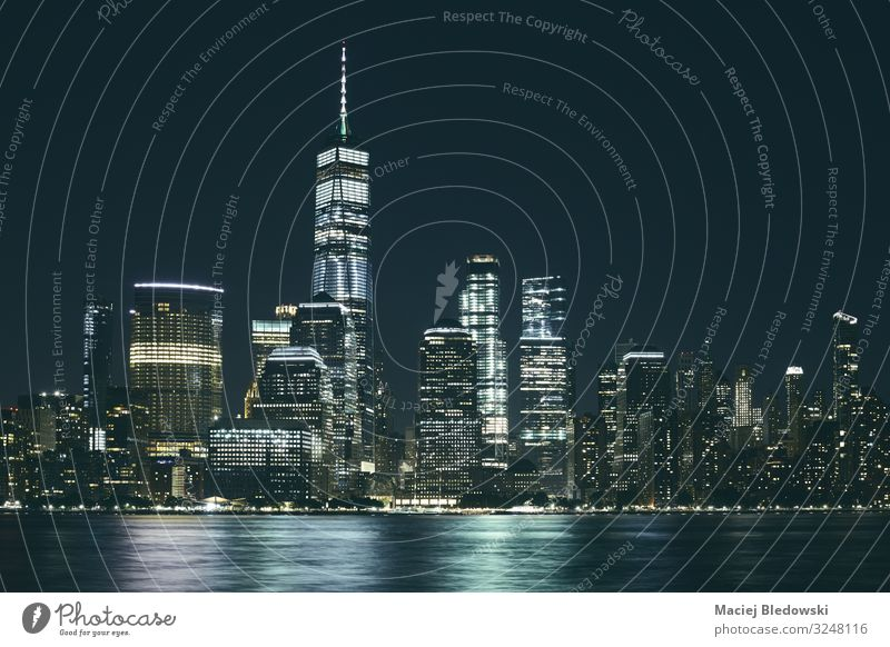 Manhattan panorama at night, USA. Workplace Office Sky Cloudless sky River Town Skyline Populated Overpopulated High-rise Building Architecture