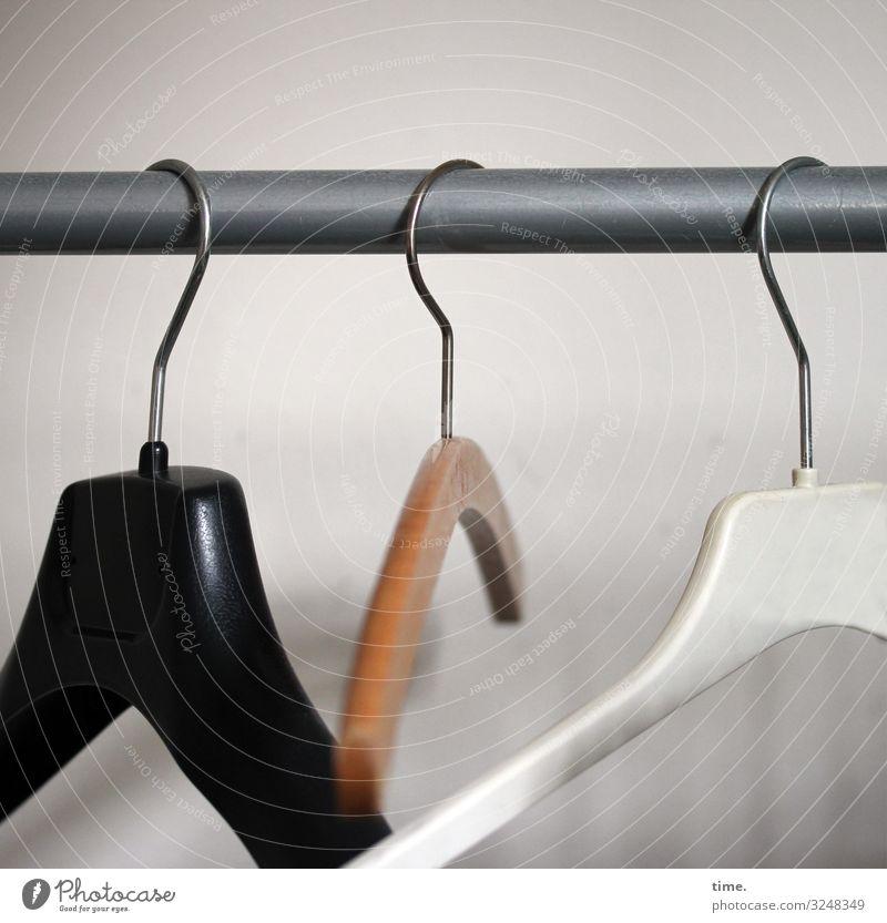 same job different style   triad Hanger wardrobe clothes rail hang Black wood White Empty forsake sb./sth. Wait service pole Metal post