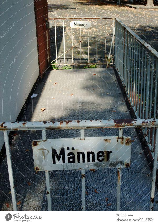 Men/Men Outskirts Kiosk Facade Stone Metal Broken Gray Red White Emotions Transience Grating Barrier Gate Signs and labeling Lettering Letters (alphabet) Toilet