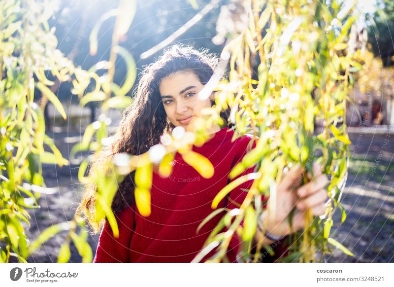 Portrait of a young woman with a red sweater Lifestyle Style Happy Beautiful Garden Schoolchild Human being Feminine Young woman Youth (Young adults) Woman