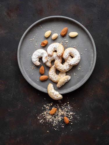 Vanilla croissant with almonds on a grey plate Food Dough Baked goods Cookie Austria Plate Christmas & Advent Rustic Table To enjoy Old Fragrance Sweet Infancy