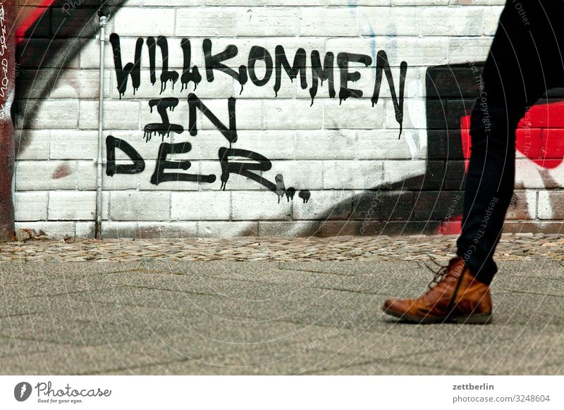 Human being Town House (Residential Structure) Legs Graffiti Wall (building) Berlin Building Copy Space Wall (barrier) Keyword City life Living or residing