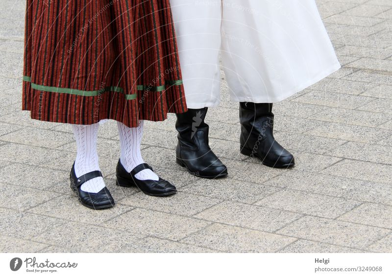Detail of a couple in traditional costume with skirt, trousers, shoes and stockings Leisure and hobbies Feasts & Celebrations Human being Legs Feet 2