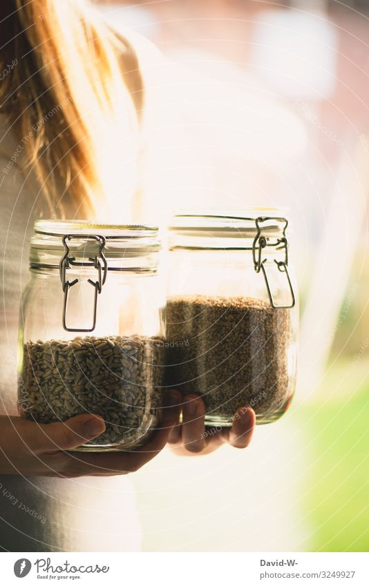 sustainable - woman with preserving jars as storage containers Sustainability sustainability Preserving jar To hold on grains do-it-yourself Healthy Eating