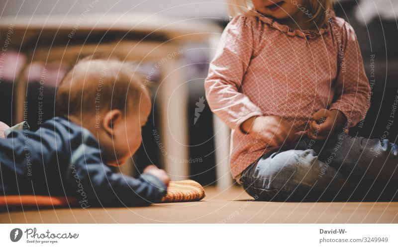 Children play together on the floor children Effortless Playing girl Boy (child) Infancy Brothers and sisters Sister occupy annoy tease sb. Sibling Small