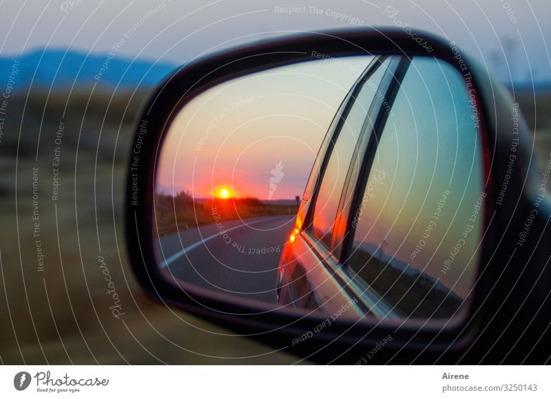 in retrospect Landscape Sunrise Sunset Beautiful weather Hill Plain Street Car Rear view mirror Car Window Mirror Reflection Driving Illuminate Authentic