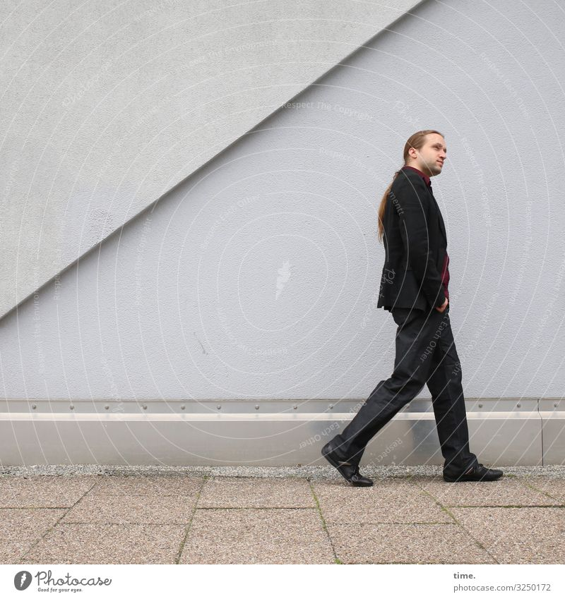 saunter mode Masculine Man Adults 1 Human being Wall (barrier) Wall (building) Lanes & trails Sidewalk Suit Brunette Long-haired Braids Designer stubble Observe