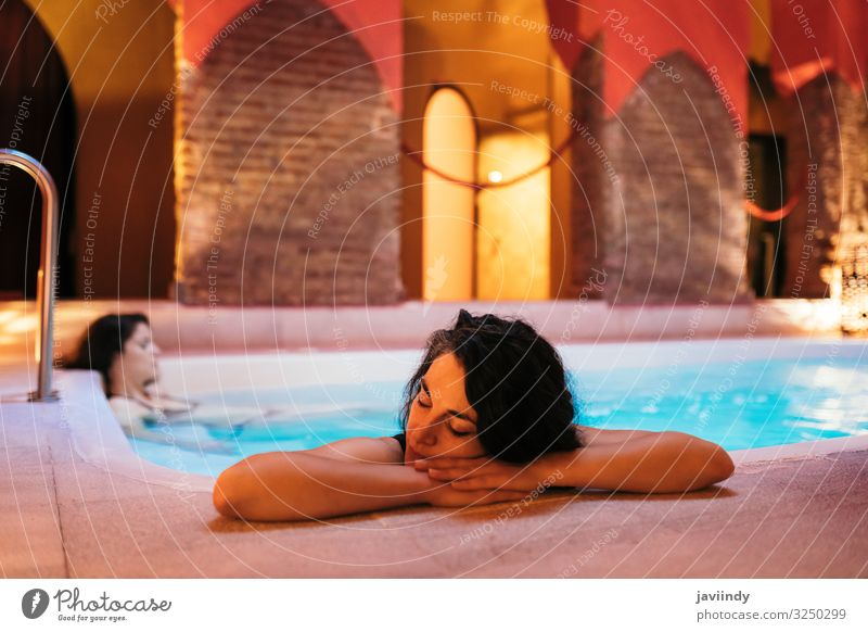 Two women enjoying Arabic baths Hammam in Granada Lifestyle Luxury Beautiful Medical treatment Relaxation Spa Sauna Swimming pool Leisure and hobbies Decoration