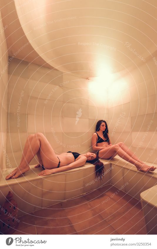 Two young women enjoying hammam or turkish bath Lifestyle Luxury Happy Body Medical treatment Wellness Relaxation Spa Sauna Leisure and hobbies Decoration