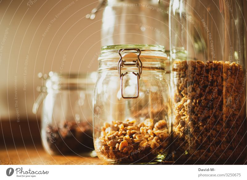 Preserving jars filled with food Sustainability sustainability preserving jars nuts Oat flakes Keep storage container Containers and vessels Colour photo Glass